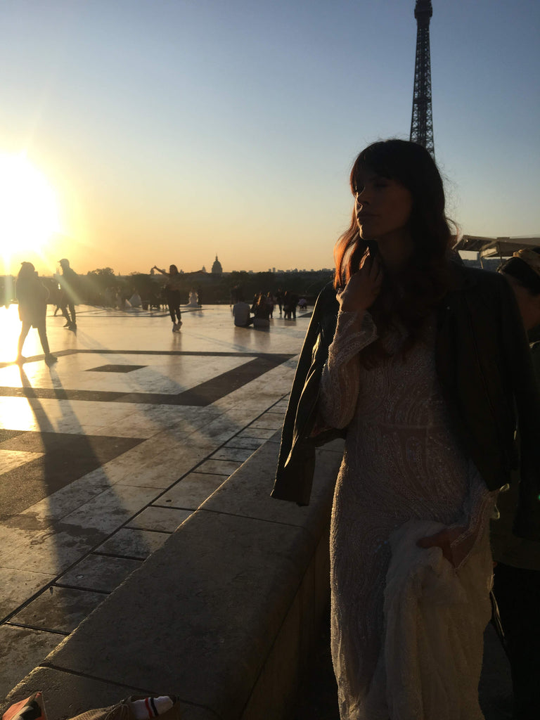 Our model wearing a wedding dress and leather jacket at the eiffel tower.