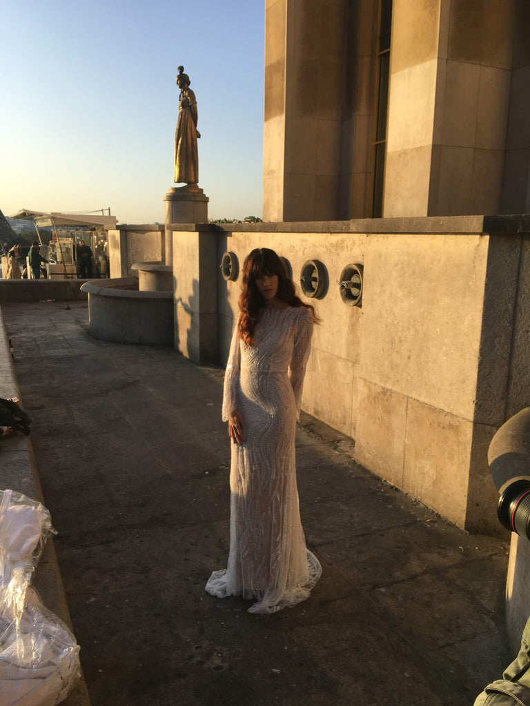 Our photographer shooting the model standing in a wedding dress at Tracadaro in Paris.