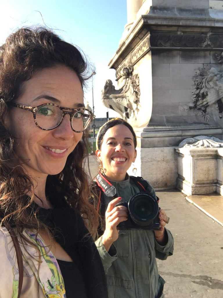 Hrissa the designer, and Violeta the photographer smiling together during the photo shoot in Paris.
