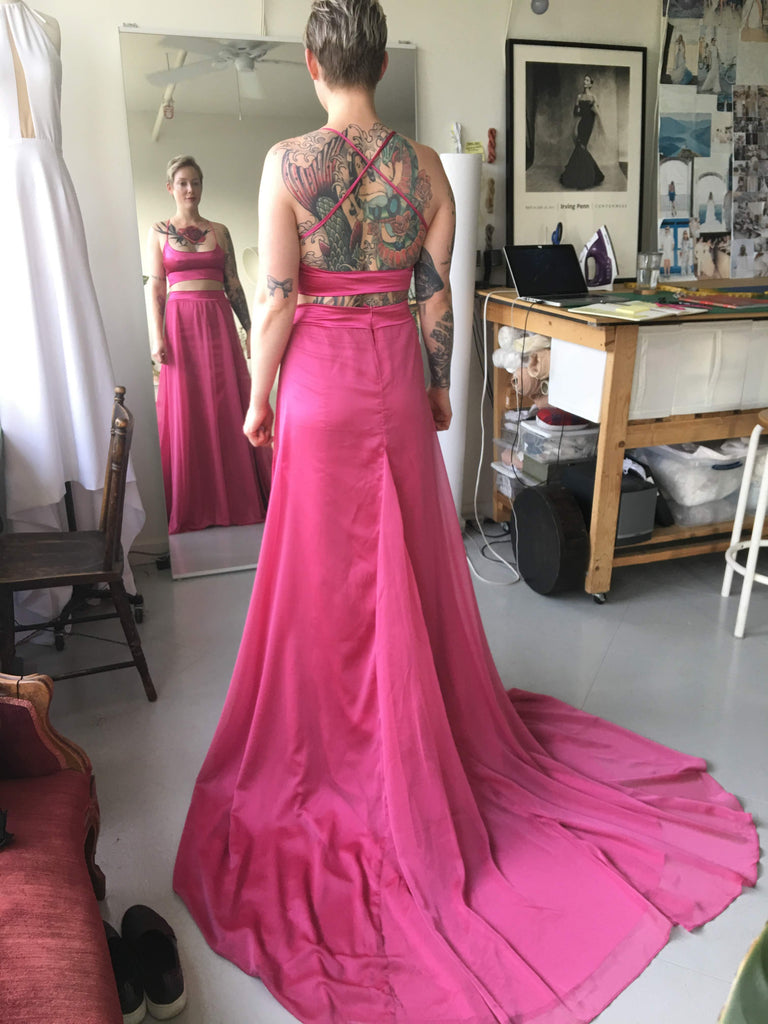 Fitting of Vancouver bride for her custom crop top wedding dress in pink chiffon.