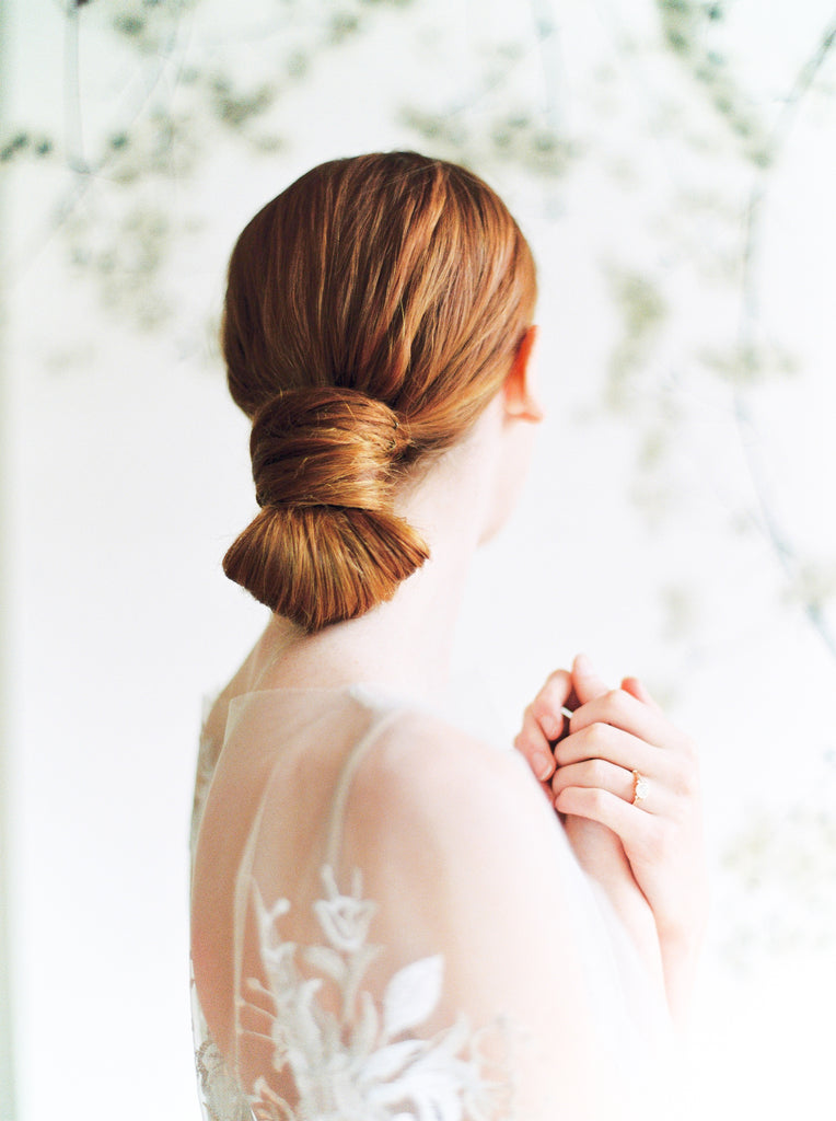 BRIDAL HAIR | SHOP DRESSES for romantic boho themed weddings. Bride close up of back of head showing off bridal hair.