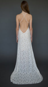 A romantic lace wedding dress made with stretch lace that is affordable and boho chic.