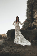 Load image into Gallery viewer, Bride with hand up in motion throwing long train of Vancouver made long sleeve wedding dress.
