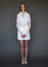 Load image into Gallery viewer, Model standing facing us, in long sleeve lace bridal jacket with draped neckline.
