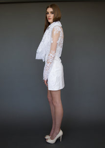 Model to the side, full length, in sheer long sleeve chic bridal jacket.