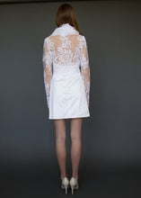 Load image into Gallery viewer, Bridal jacket from behind, with model showing lace back detail over skin.