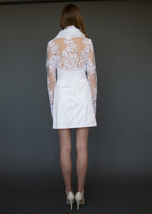 Bridal jacket from behind, with model showing lace back detail over skin.