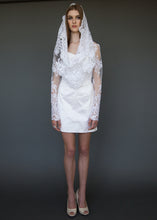 Load image into Gallery viewer, Model standing, in short wedding dress and lace cropped jacket.