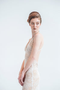 wedding dress designers Elika In Love creates a sexy backless lace wedding dress for the bohemian bride.