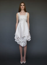 Load image into Gallery viewer, Model posing full length wearing short, belted, A-line wedding dress with straps.