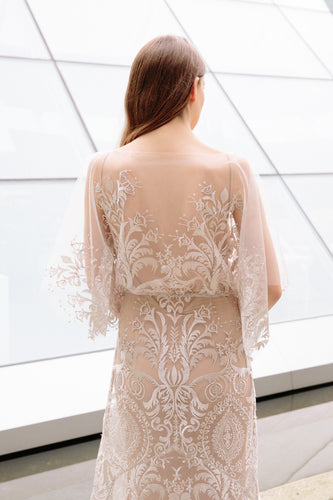 Back of bride wearing boho inspired half sleeve lace wedding dress by Elika In Love, a Vancouver wedding dress shop.