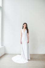 Load image into Gallery viewer, A boho chic wedding dress with sexy low V neckline, natural waist, and long train made in Vancouver.