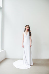 A boho chic wedding dress with sexy low V neckline, natural waist, and long train made in Vancouver.