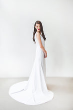Load image into Gallery viewer, An ivory boho wedding dress with fit and flare skirt and long train.