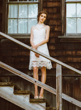 Load image into Gallery viewer, models standing on stairs wearing a high neck lace wedding dress.