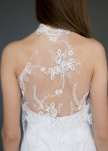 Load image into Gallery viewer, Detail shot of back of model wearing lace overlay dress over short strapless wedding dress.