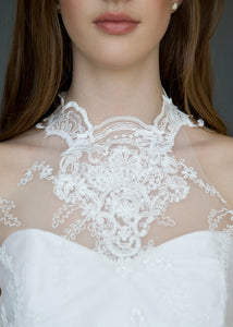 Detail shot of model's neck, wearing high neck Victorian style lace wedding dress.