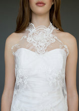 Load image into Gallery viewer, Close up of torso of strapless wedding dress with high neck lace overlay in a short version.