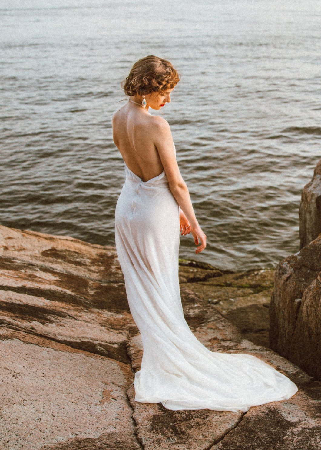 Back view of low back sheath wedding dress on Vancouver bride.