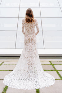Vancouver wedding dress, back full view, with full skirt and bold lace pattern.