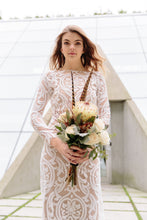 Load image into Gallery viewer, Vancouver lace wedding dress, worn by woman holding flowers, in bold lace.