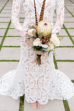Load image into Gallery viewer, Long sleeve lace worn by bride, in a body shot holding flowers, showcasing long sleeve lace gown.
