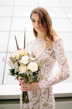 Load image into Gallery viewer, Side view of bridal bouquet of boho bride wearing Vancouver designer fit-and-flare lace wedding dress.