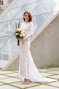 Boho lace wedding dress shot on model facing to the side in Vancouver.