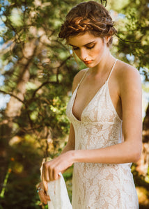 A unique low V neck open back lace bridal gown made in Vancouver.