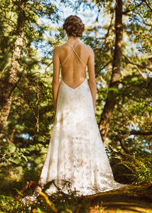 A unique backless lace wedding dress handmade in Vancouver.
