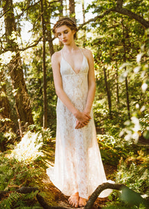 A unique low neck backless lace wedding dress made in Vancouver.