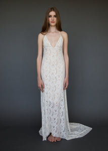 A sexy low V neck open back lace bridal gown made in Vancouver.
