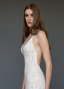A sexy low V backless lace bridal gown uniquely made in Vancouver.
