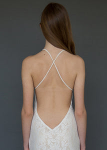A strappy cross over backless lace bridal gown uniquely made in Vancouver.