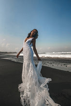 Load image into Gallery viewer, Vancouver bride dancing on beach holding skirt of low back lace wedding dresses.