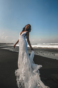 Vancouver bride dancing on beach holding skirt of low back lace wedding dresses.