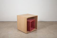 A veneered cube side table