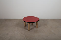 Round red stained veneer side table