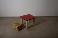 A red stained veneer side table