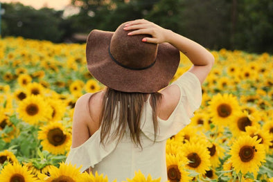 Lady in field of sunflowers