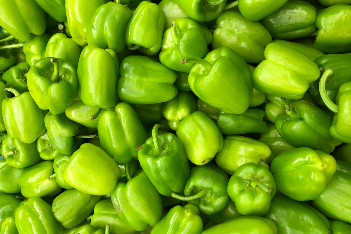 a pile of bright green peppers