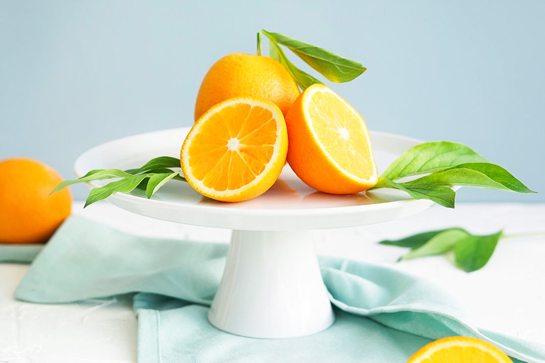 Cut orange on a plate
