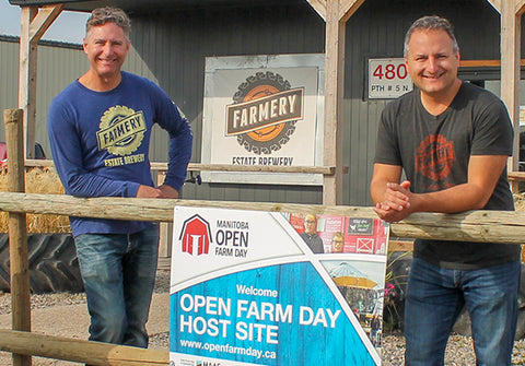 Farmery at Open Farm day standing on porch ready to give tours