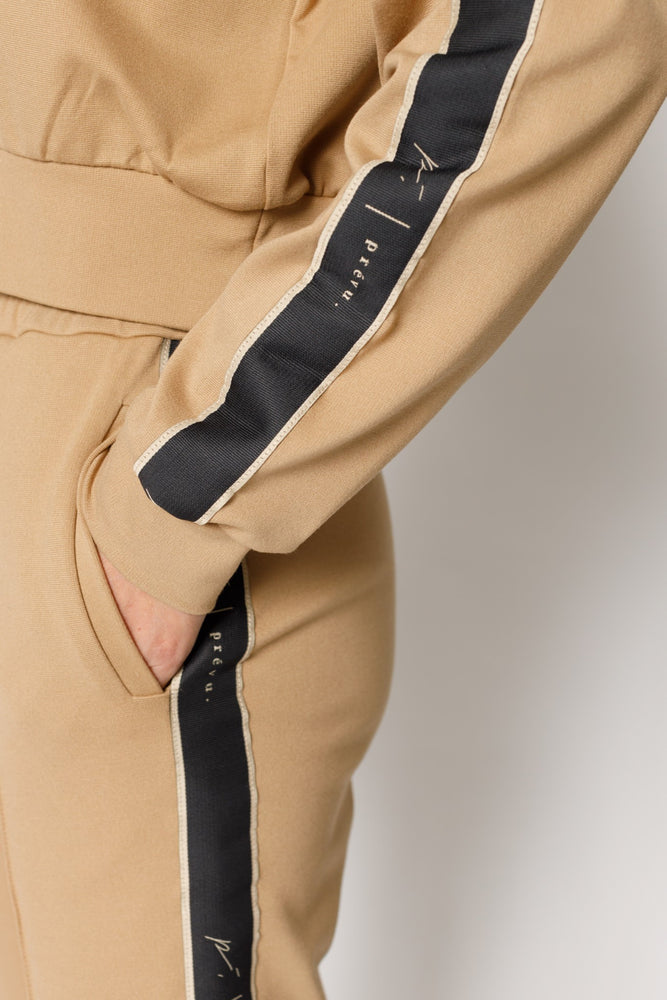 Load image into Gallery viewer, Women's Tan Ripley Tape Skinny Fit Joggers - P r é v u . S t u d i o .