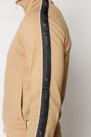 Load image into Gallery viewer, Tan Ripley Taped Track Jacket - P r é v u . S t u d i o .