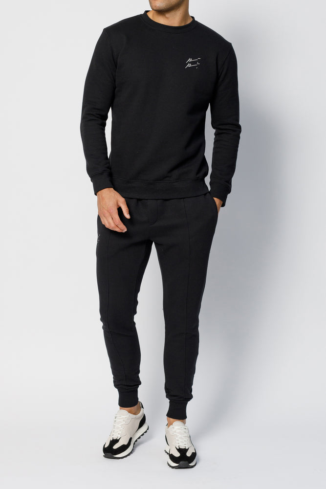 Load image into Gallery viewer, Black Double Logo Slim Fit Joggers - P r é v u . S t u d i o .