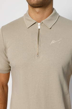 Load image into Gallery viewer, Stone Signature Logo Zip Neck Slim Fit Polo - P r é v u . S t u d i o .
