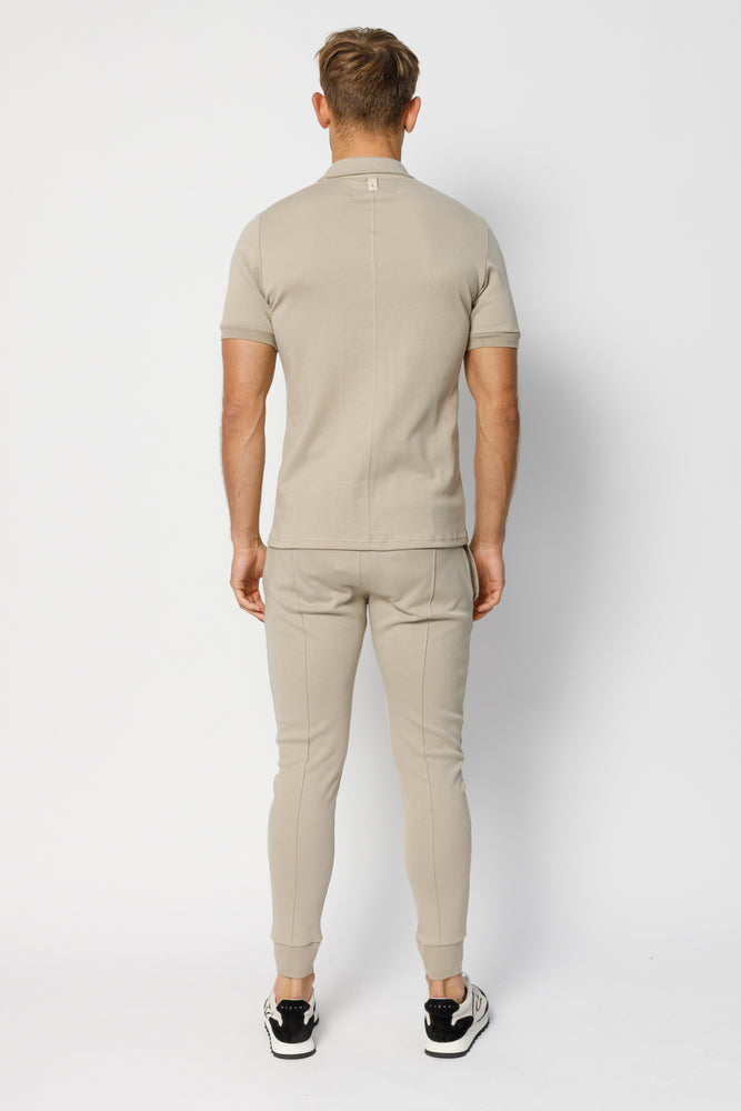 Load image into Gallery viewer, Stone Signature Logo Slim Fit Jogger - P r é v u . S t u d i o .