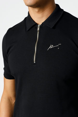 Load image into Gallery viewer, Black Signature Logo Zip Neck Slim Fit Polo - P r é v u . S t u d i o .