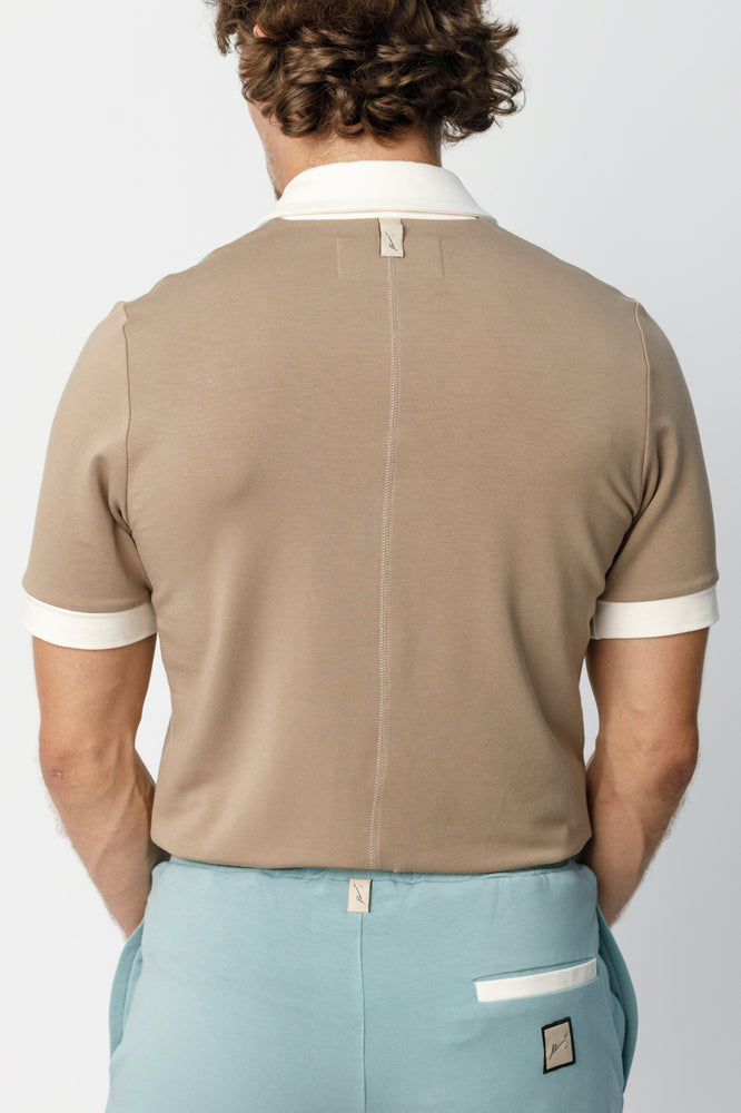 Load image into Gallery viewer, Beige Calvia Panelled Slim Fit Polo - P r é v u . S t u d i o .